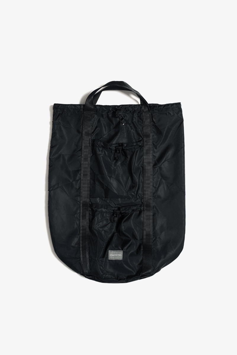 "UNAFFECTED Logo Label Sling Bag ""Black"""